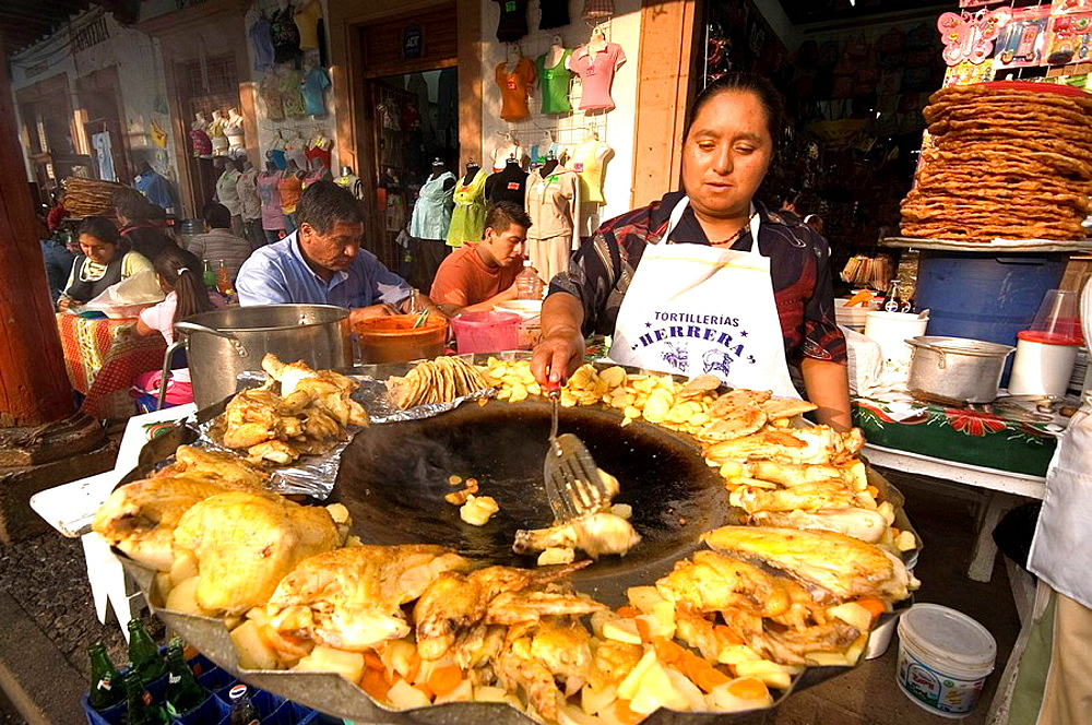 Food stalls under the arcades of the ' plaza chica', Patzcuaro, Michoacan State, Mexico