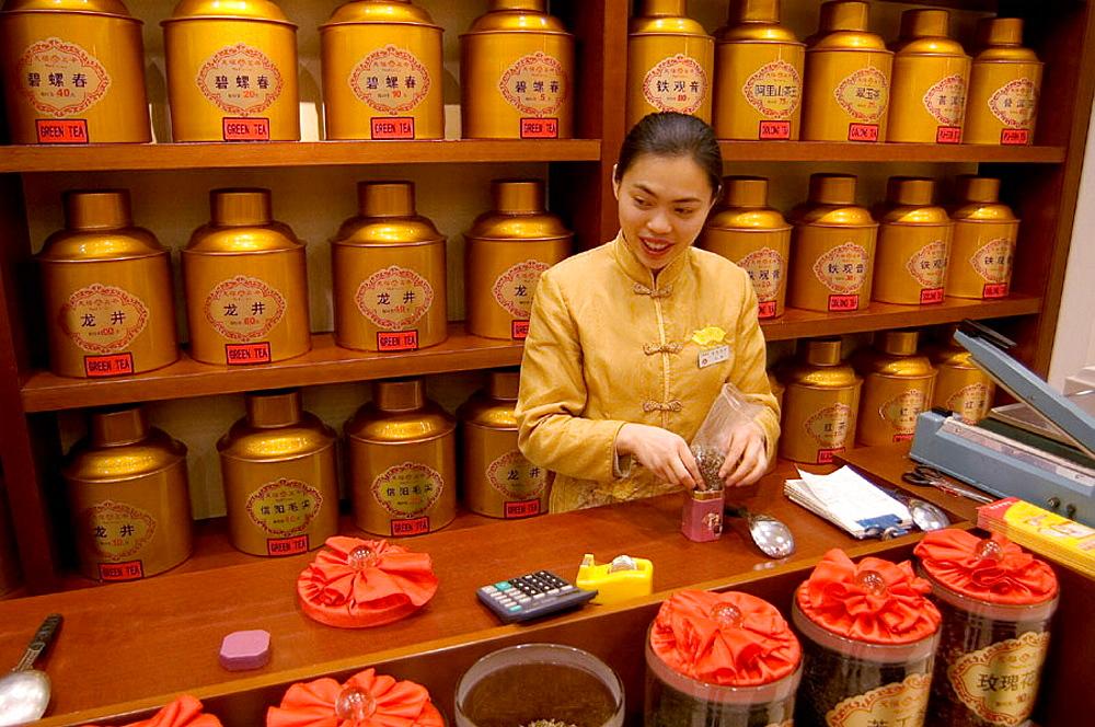 Sales clerk in tea shop, Beijing, China