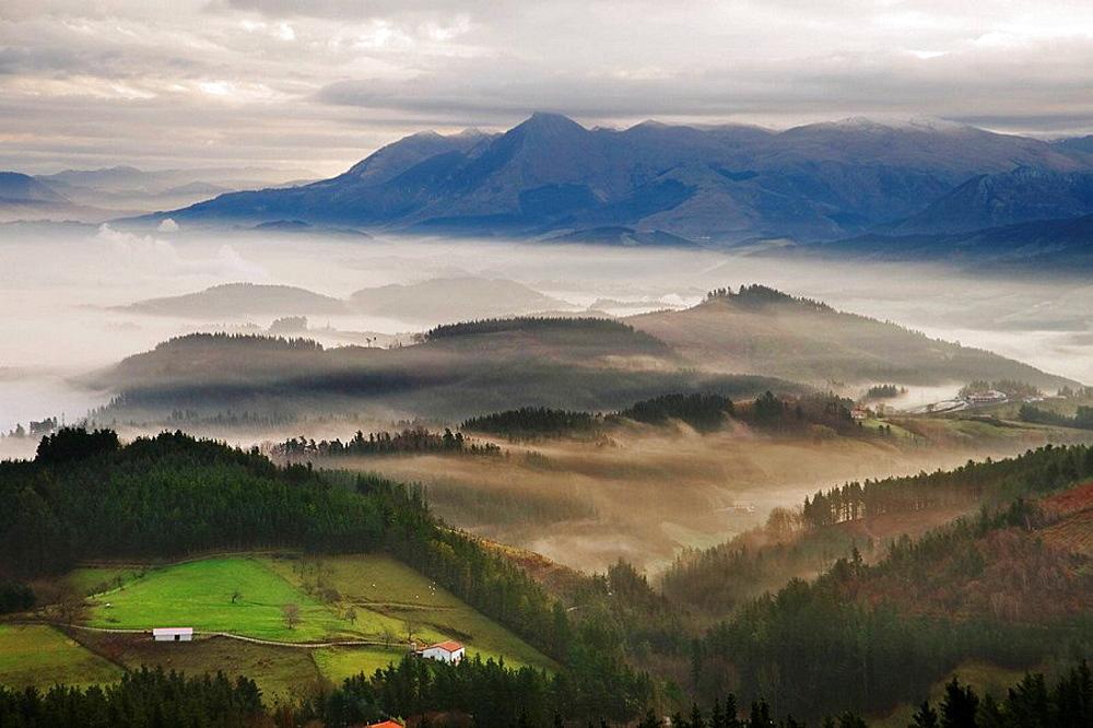 Fog over Goierri valley with Txindoki mountain of the Aralar mountain range in background, Guipuzcoa, Basque Country, Spain