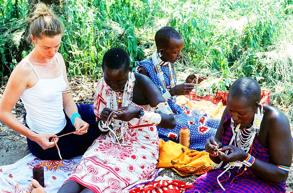 Dressmakers at Masaai village ('manyatta'), Rift Valley, Kenya