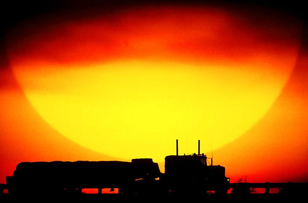 Truck on Highway, giant sun