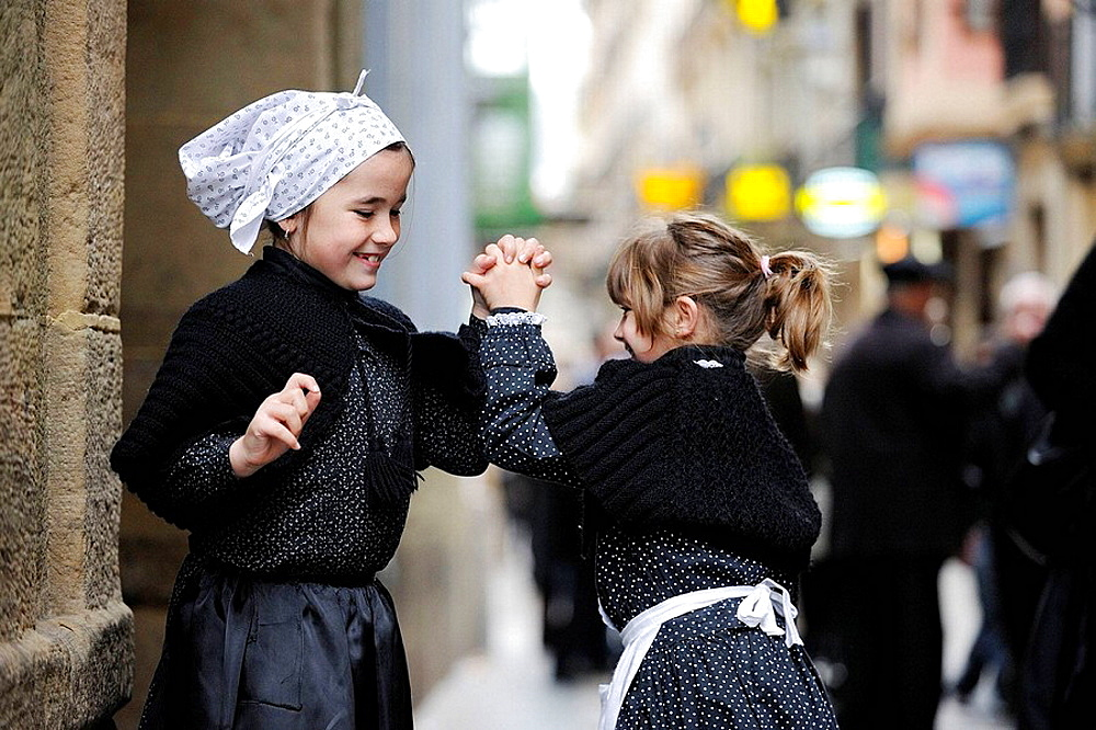 Girls dressed in costumes playing in the streets of San Sebastian, Donostia, Basque country, Spain
