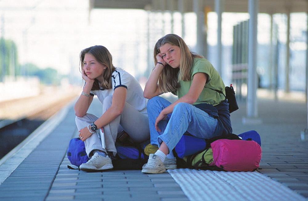 Teens waiting at train station