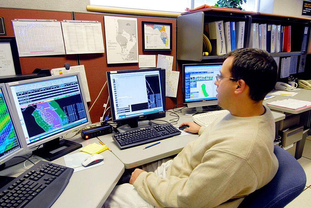 Meteorologist in Work Area in National Oceanic and Atmospheric Administration (NOAA), National Weather Service Station, Ruskin, Florida, Tampa, Hillsborough County, Gulf West Central, USA - 817-147170