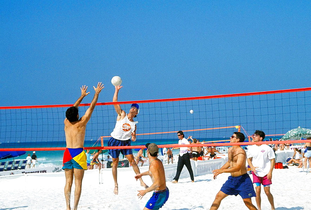 College students play beach volleyball during spring break Panama City Florida