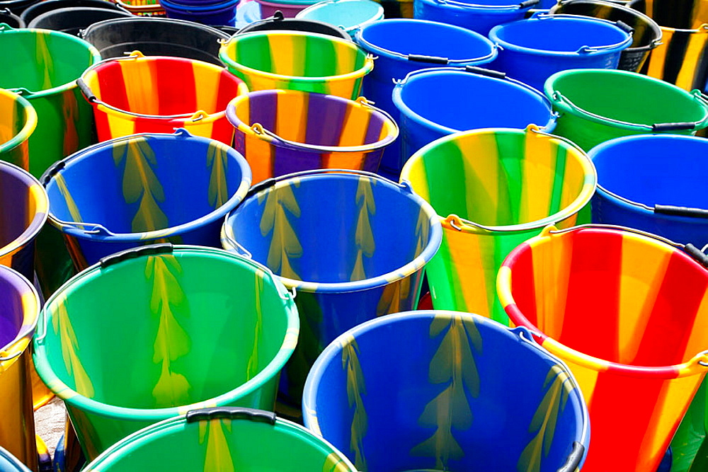 Multi-coloured buckets at market, Loropeni, Burkina Faso