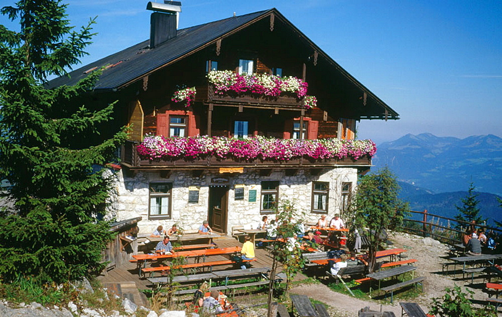 Mountain Hut on top of Pendling Mountain near Kufstein, Austria by the river Inn Valley offering traditional food and drinks with a panoramic mountain view