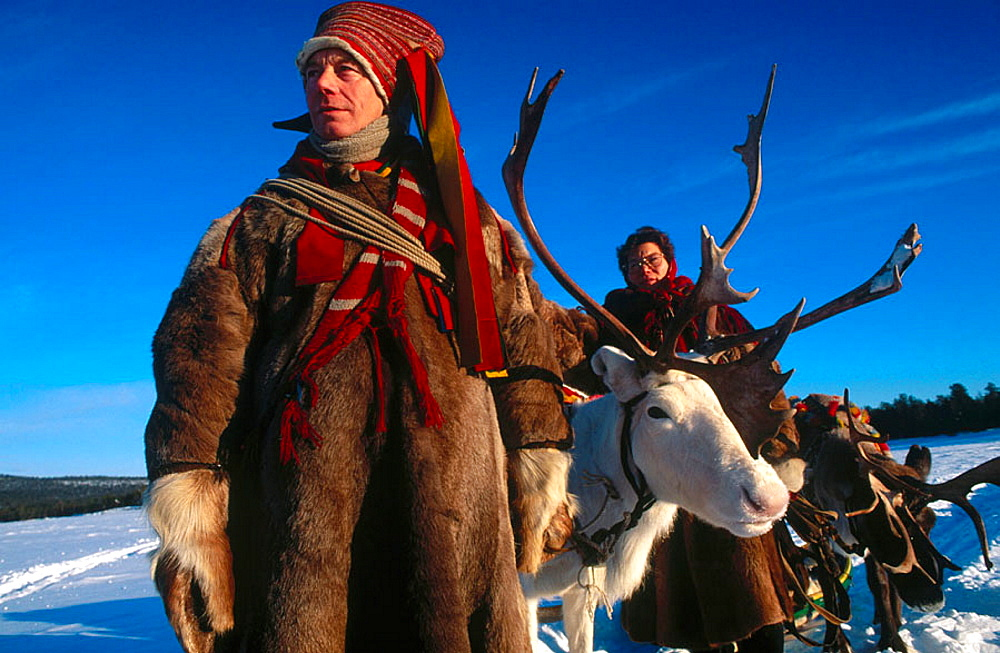 Lapps with traditional costumes and reindeer, Inari lake, Lapland, Finland. - 817-15455