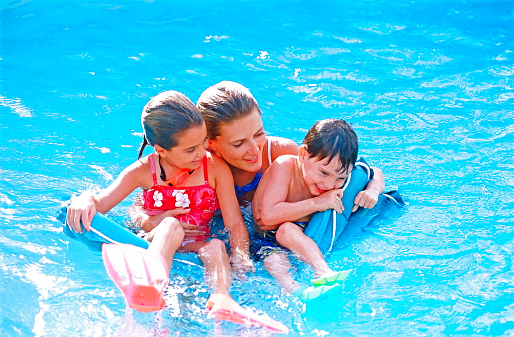 mother and kids in a pool