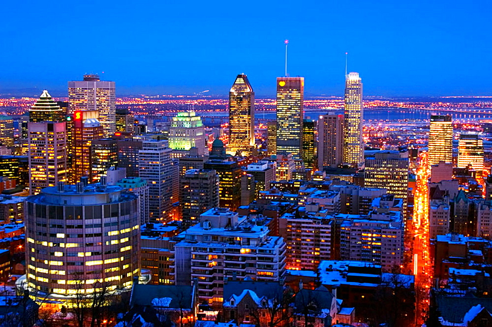 Nighttime view of downtown Montreal skyline and South Shore from atop Mount Royal (Mont Royal) in winter, Quebec, Canada