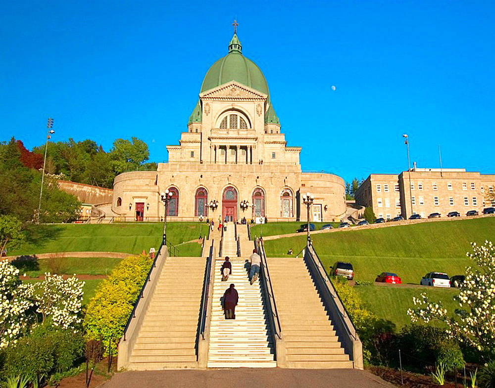 Family of worshippers climbing up the many steps of St-Josephs Oratory (Oratoire St-Joseph) on their knees, Montreal, Quebec, Canada