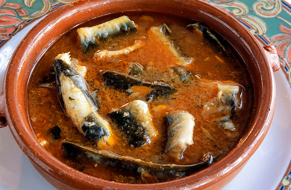 Eel with sauce, Typical gastronomy from the Delta del Ebro area, Tarragona, Spain.