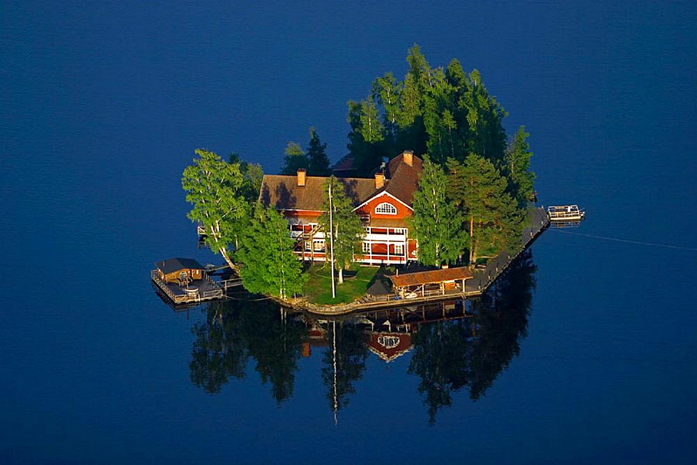 Big house on small island in lake, Soderhamn, Sweden