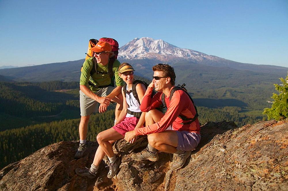 Three friends take a break while hiking near Mount Adams, Washington, USA