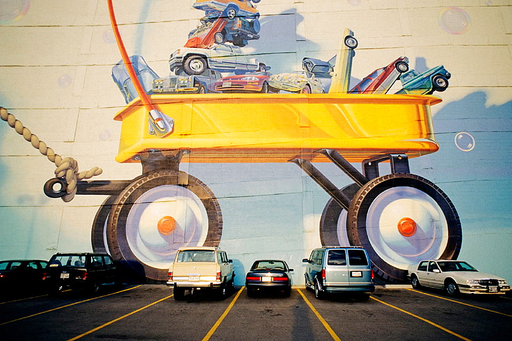 Wagon mural in front of parking lot, Dallas, Texas, USA