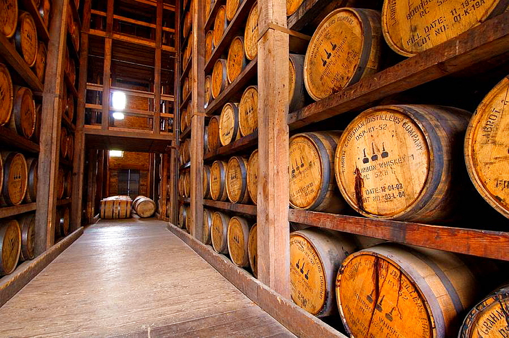 Oak barrels in the aging warehouse made of stone, Woodford Reserve Distillery premium bourbon, Versailles near Lexington, Kentucky USA