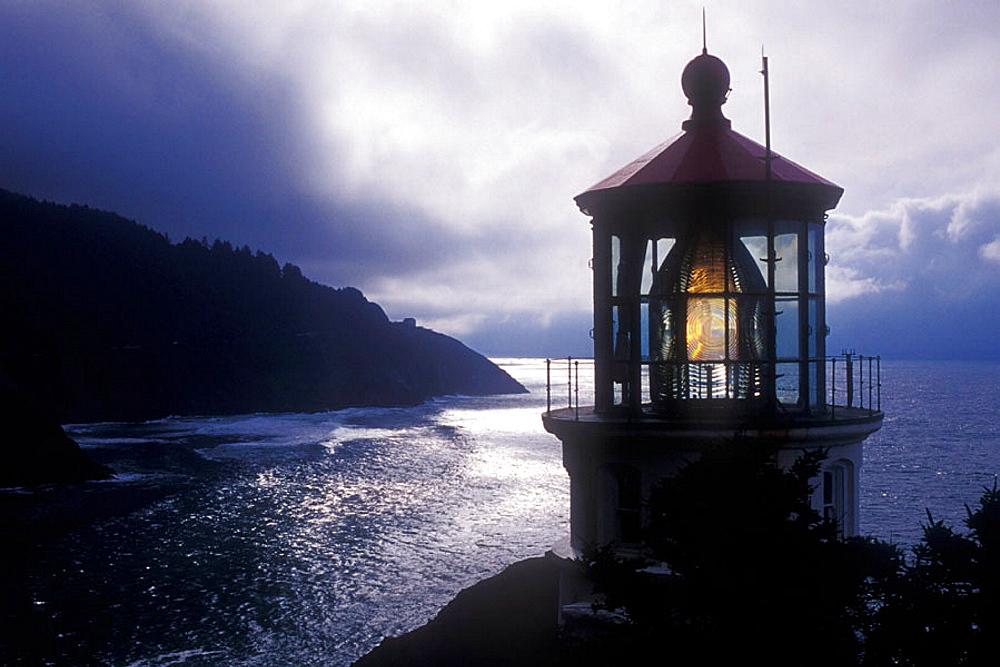 The Heceta Head Lighthouse is circa 1894, The lighthouse is a working lighthouse, From a height of 205 feet above the ocean, it'ÄövÑv¥s 'ÄövÑv?first order'ÄövÑvp Fresnel lens, casts it'ÄövÑv¥s beams some 21 miles out to sea, Oregon, USA