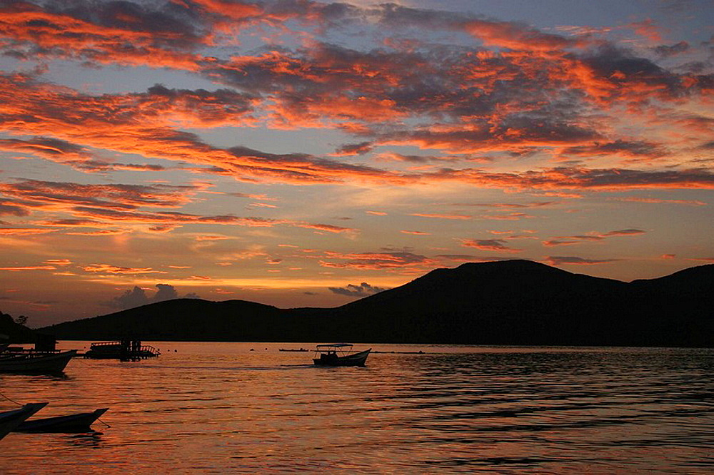 Sunset and fishing boats over Mochima National Park, Sucre, Venezuela