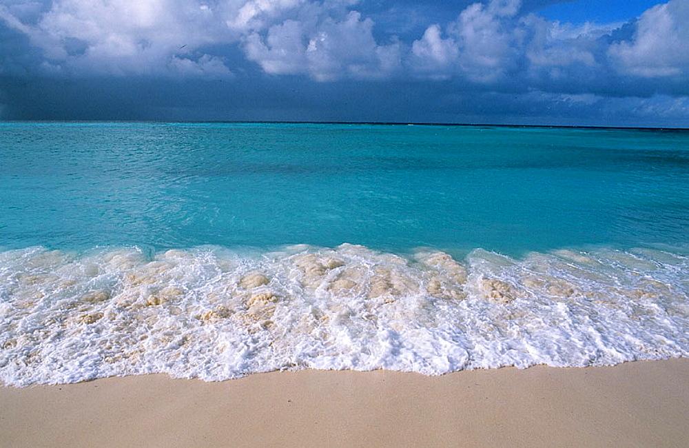 Beach, surf and tropical sky, Bird Island, Seychelles