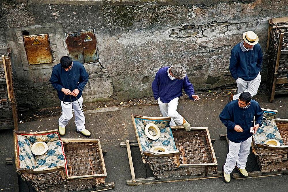 The tooggan drivers at the toboggan run near Monte in Terreiro da Luta, Funcahl, Ilha da Madeira, Portugal