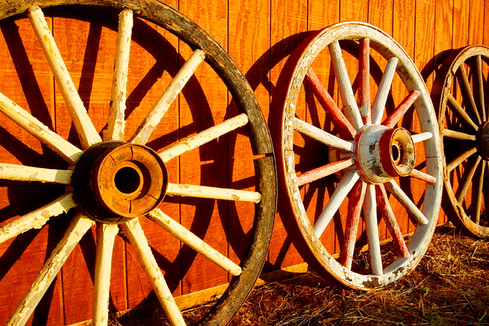 Wagon wheels, Tongue River Ranch, Guthrie, Texas, USA - 817-176485