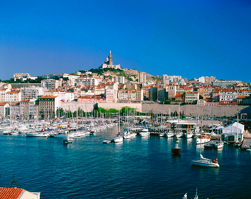 Old harbour, Church of Notre Dame de la Garde on the top of the hill, Marseille, France