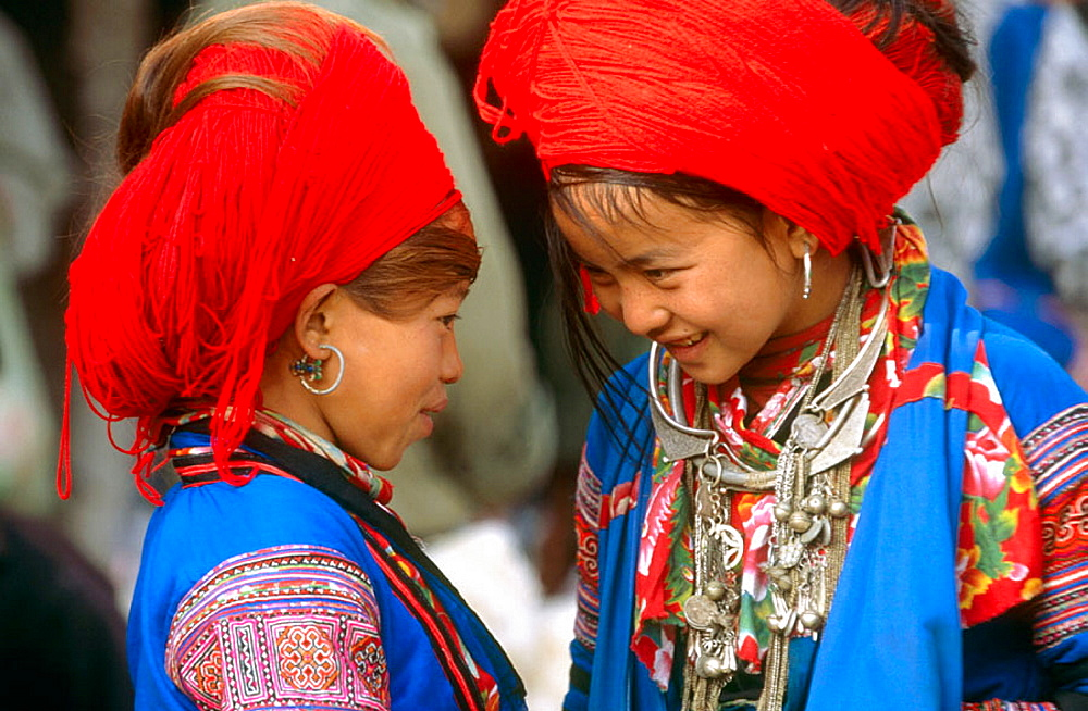 Ethnic red HMong girls from Northern Vietnam are famous for their Yarn-wrapped Big hair, Lai Chau province, Vietnam.