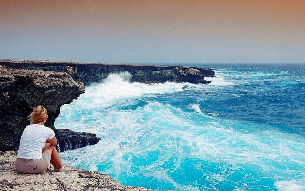 Woman and stormy coast, Netherlands Antilles, Bonaire, Caribbean Sea, Washington Slagbaai National Park, Suplado