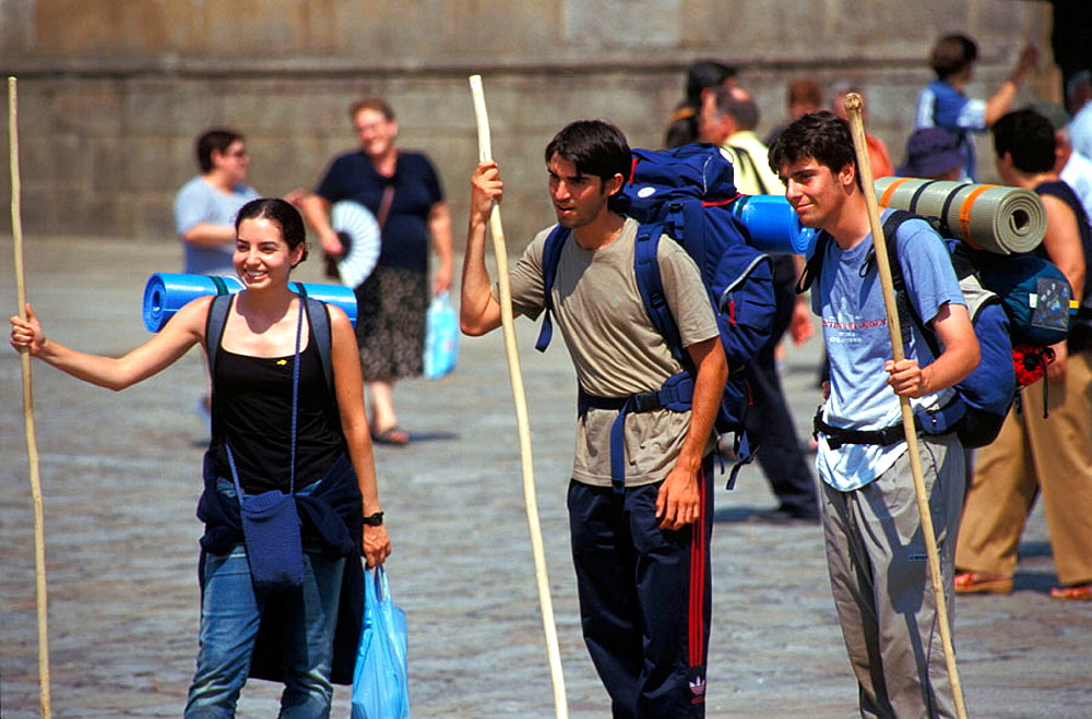 Young pilrgims in front of cathedral at Santiago de Compostela, Spain