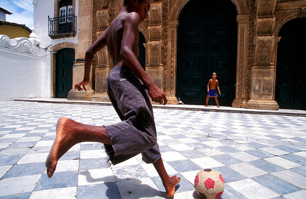 Boys playing football on the street, Salvador da Bahia, Brazil - 817-187438