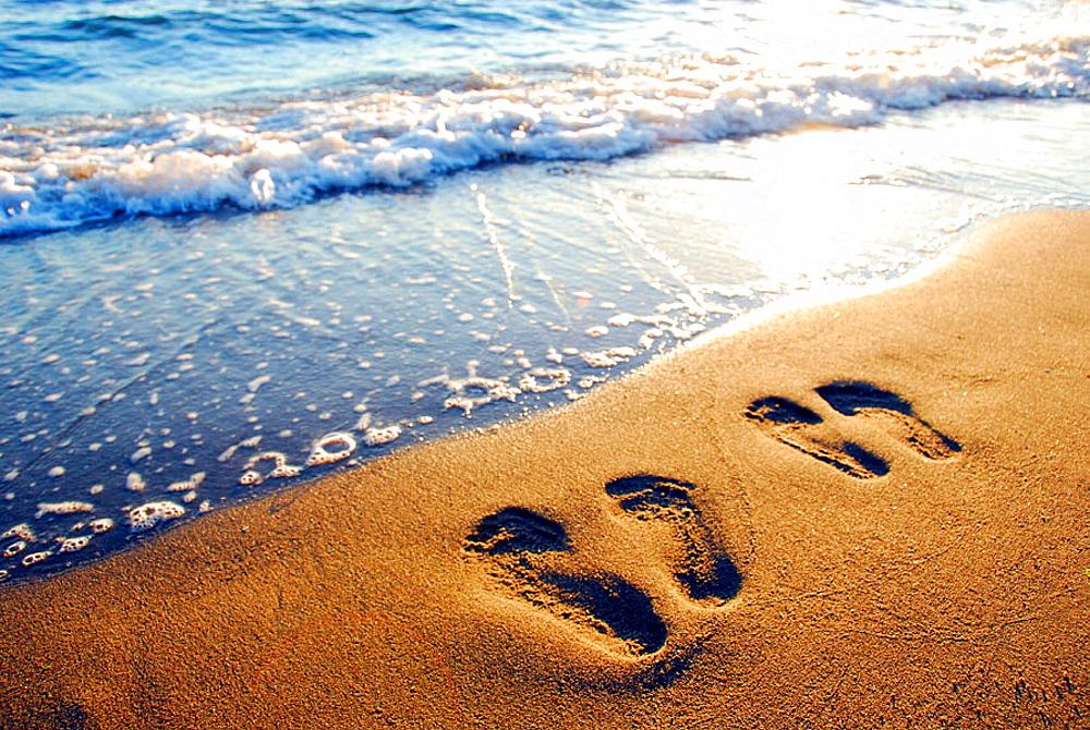 couples footprints on beach,