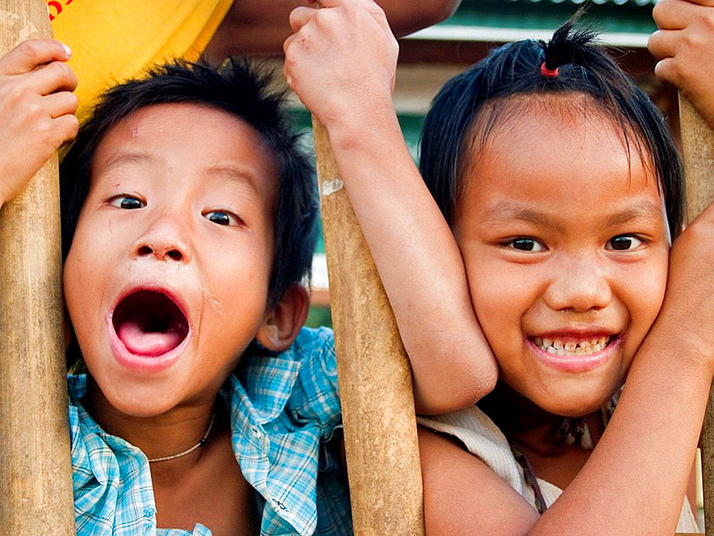 Kids at play along their fence at Inle Lake in Burma