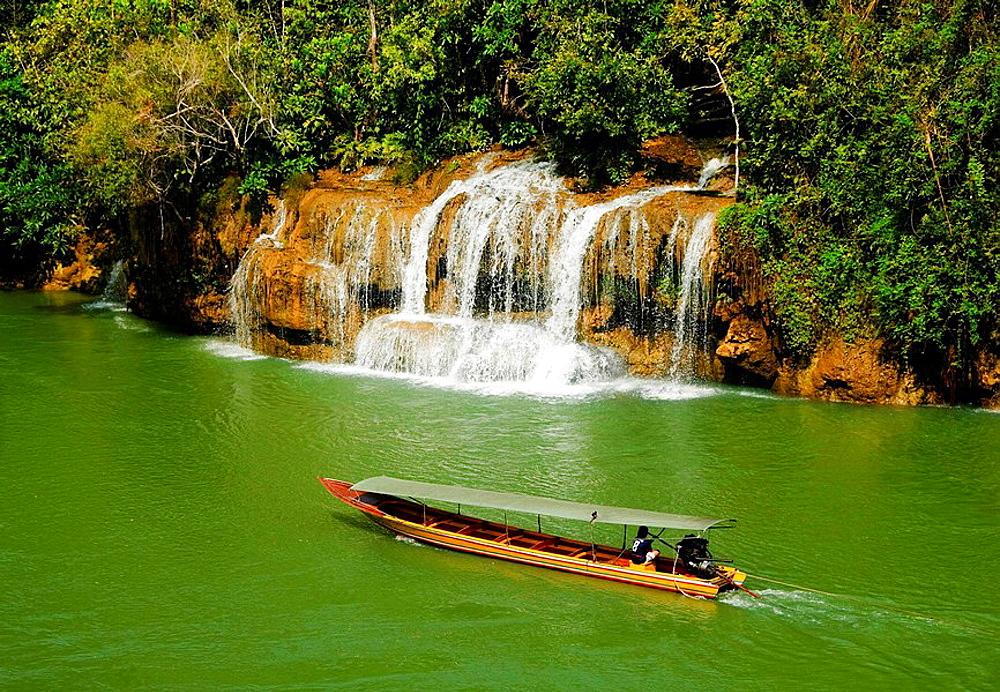 longtail boat on the Kwai River in Sai Yok National Park in Kanchanaburi Thailand