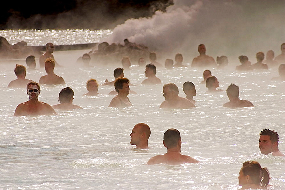 Bathers in the termal treatment center in Blue Lagoon, Iceland - 817-192319