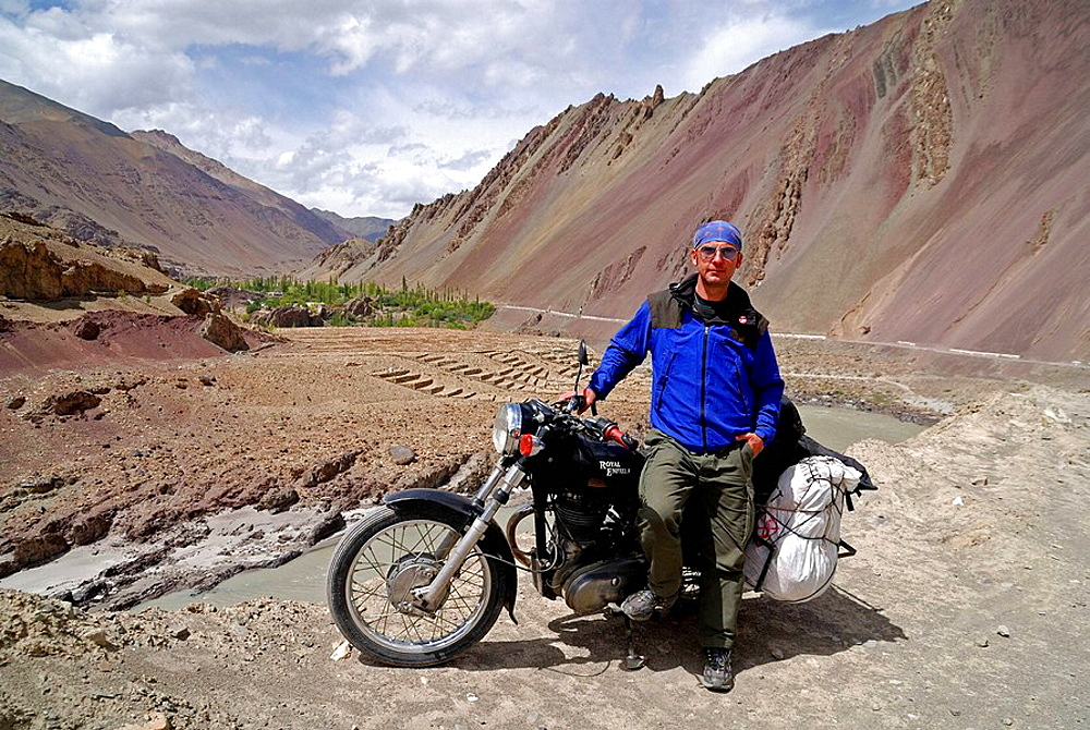 A Tourist is driving Enfield in the Himalayas
