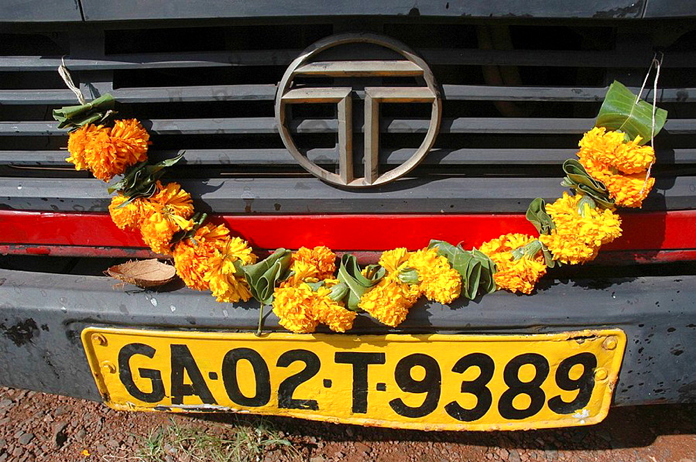 Panjim Goa, India: a Tata truck decoarted with flowers in occasion of Durga Puja Durga Hindu godness' feast, October