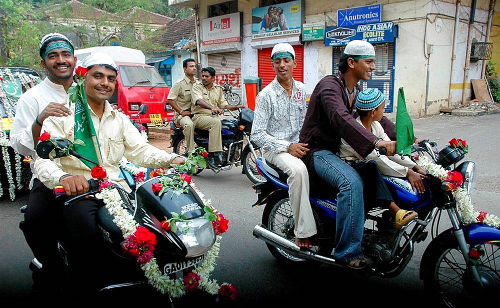 Panjim Goa, India, Muslims on motor-bikes during the Jashn-Eid-Milad Un Nabi feast, to commemorate prophet Mohammed's birth