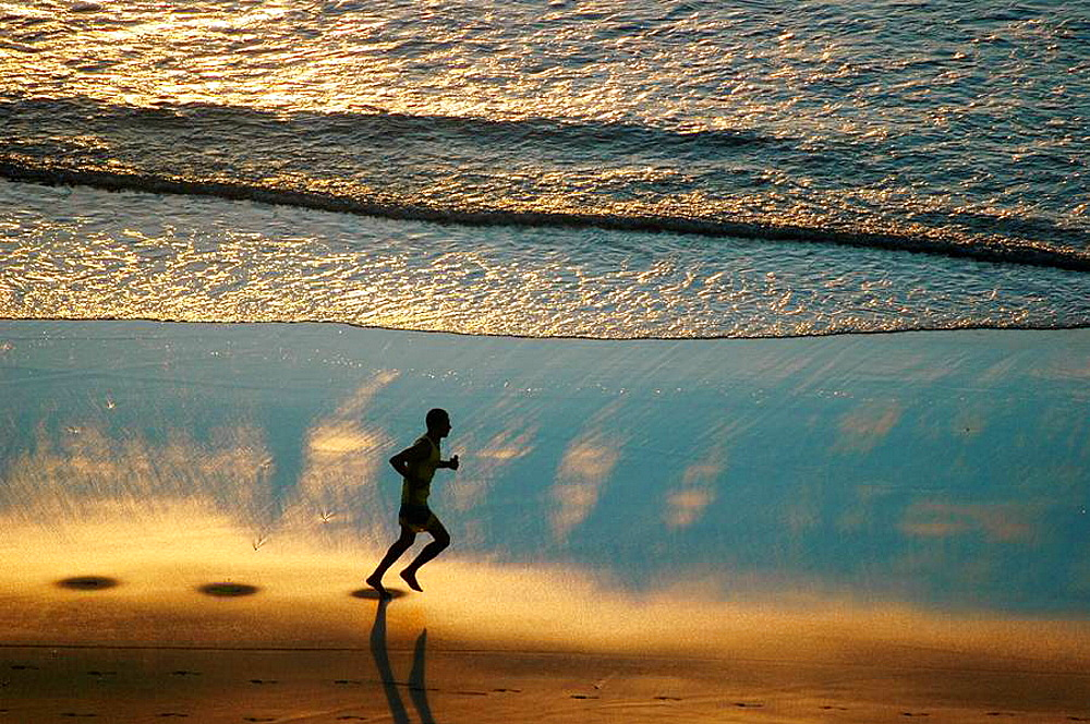 Jericoacoara (Ceara, Brazil): a man jogging at sunset along the beach - 817-194443
