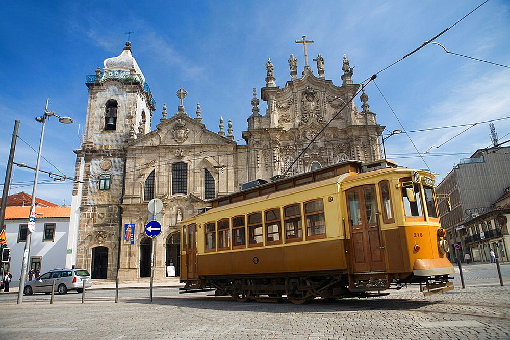 Overview of the Carmo Church  Old tram in a square of Oporto  World Heritage  Portugal