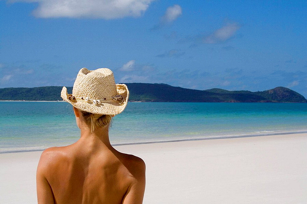 Back of a woman wearing a cowboy hat, Whitehaven Beach, Australia