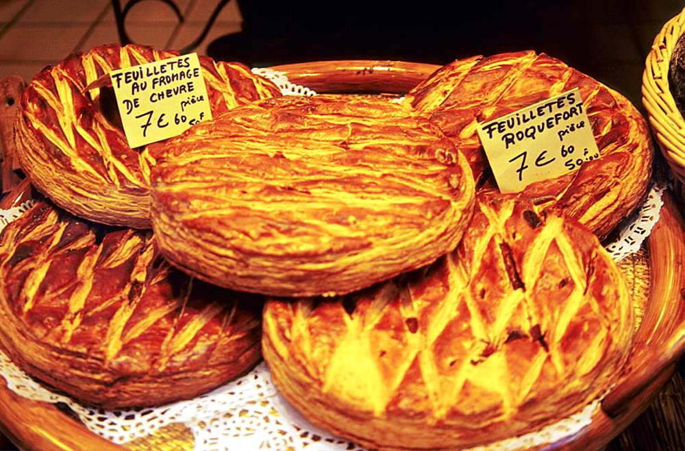 Pastry products displayed for sale in Perigueux, The region offers a wide variety of traditional French cuisine, 2005, Perigueux, Dordogne, France