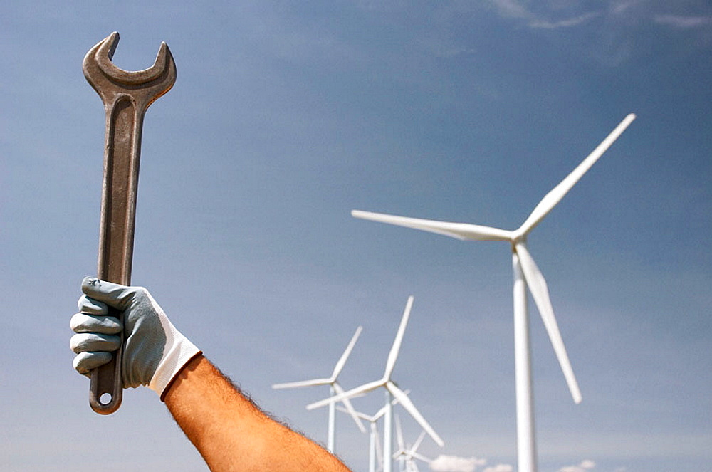 Holding a wrench in a windfarm in Navarra, Spain - 817-198841