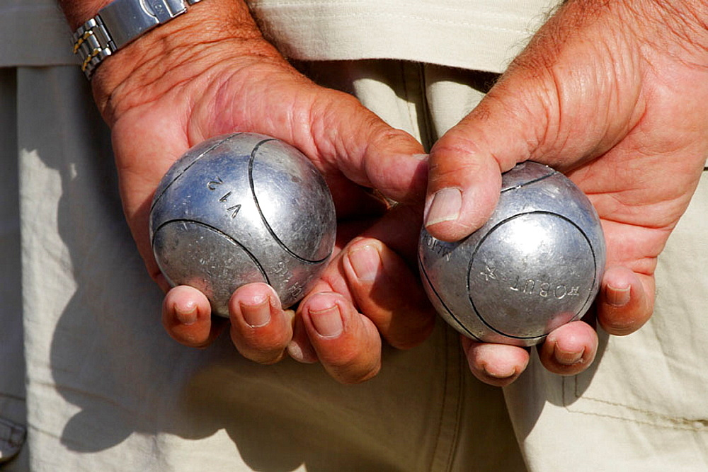 Hands with iron balls, Petanca game, Alicante, Comunidad Valenciana, Spain