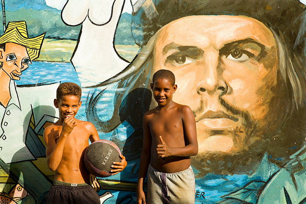 Che Guevara mural, Children playing football, Baracoa, Guantanamo province, Cuba