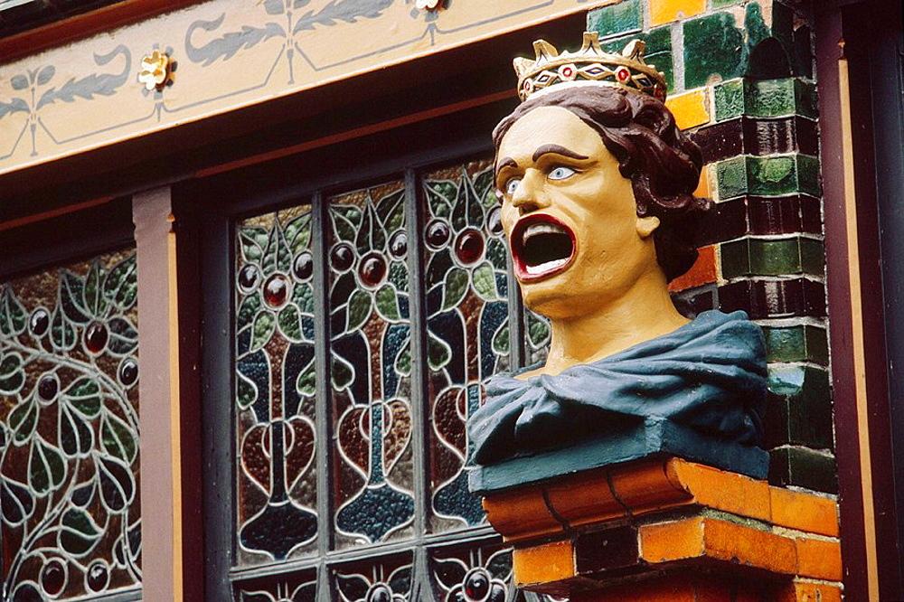 Netherlands, Enkhuizen, Zuiderzeemuseum (Zuiderzee  museum), figure with mouth wide open hangs outside a Dutch pharmacy