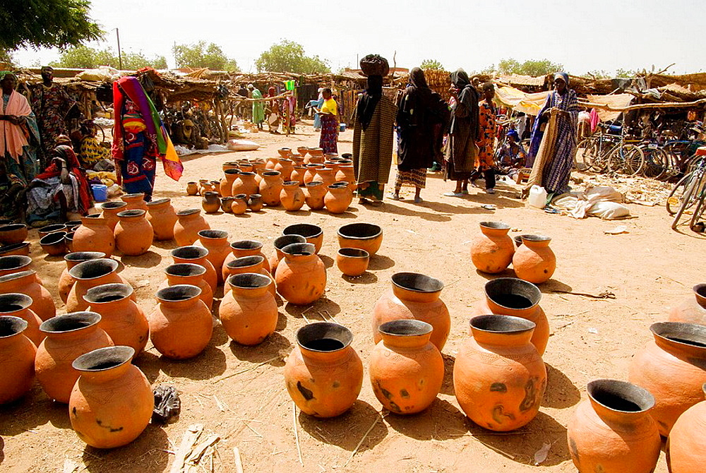 Burkina Faso, Sahel.Weekljy market of Gorom-Gorom, Traditional ceramics and bella women.