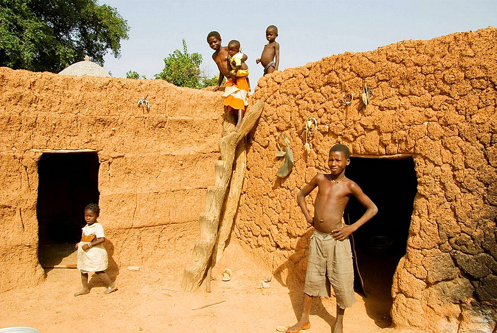 Burkina Faso, Sahel, Lobi Country, Sukala traditional house,  Family, Home animist.