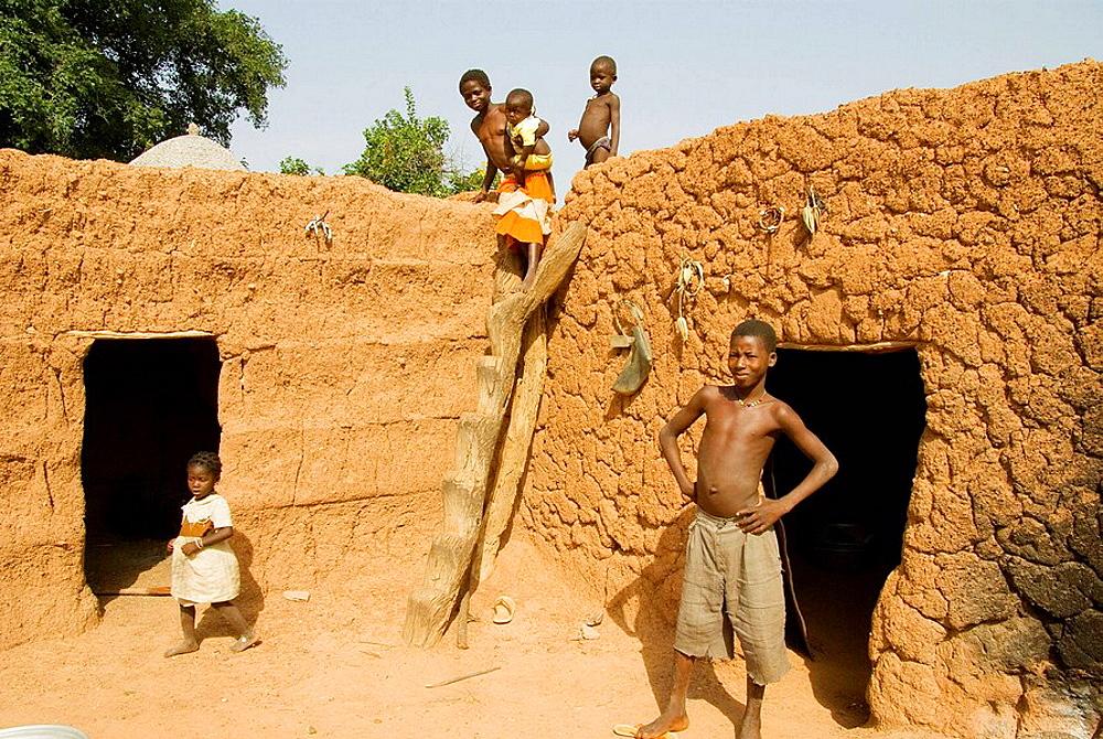 Burkina Faso, Sahel, Lobi Country, Sukala traditional house,  Family, Home animist.