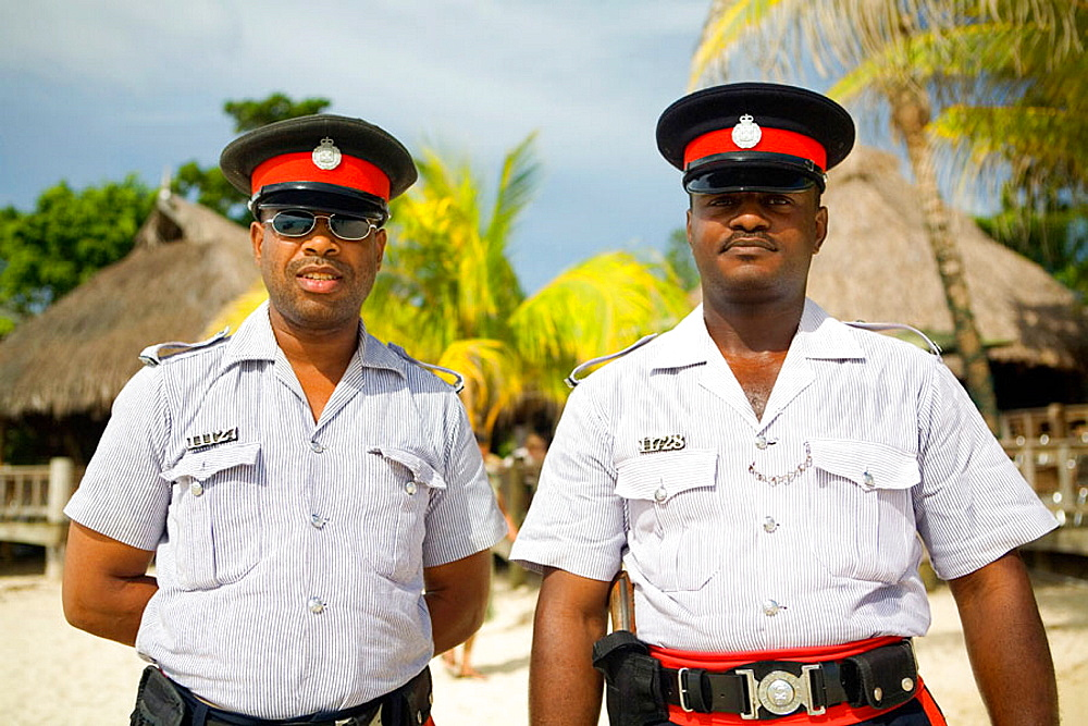 Jamaican policemen Red Stripes Negril beach, Jamaica