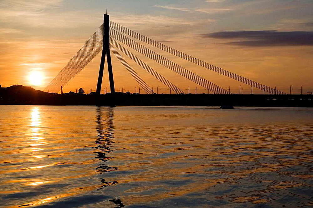 Cable bridge over Daugava river at sunset, Riga, Latvia